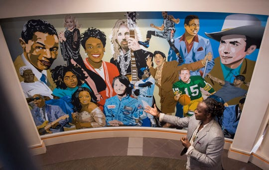 Artist Bill Ford talks about his new murals at the Morgan Memorial Library in Montgomery, Ala., on Wednesday, Oct. 23, 2019.