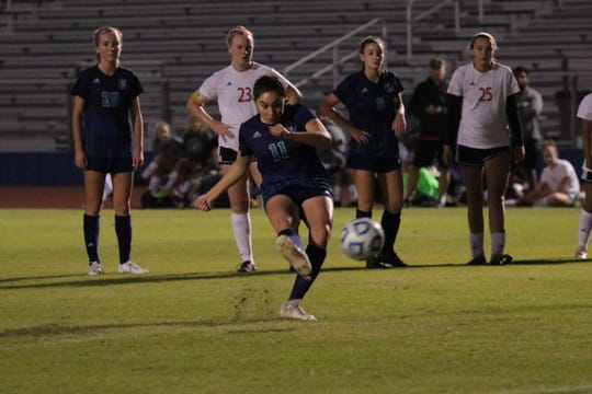 Siegel's Emily Sanchez gets her foot into a penalty kick that gave the Lady Stars a 1-0 lead en route to a 3-0 win over Coffee County in the Region 4-AAA semifinals Tuesday.