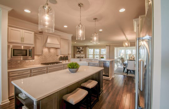 This Southern Springs kitchen has an island and stainless appliances.