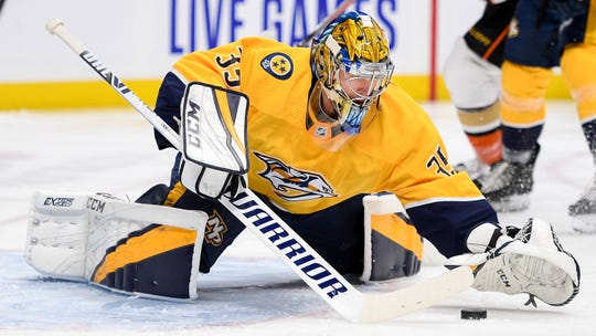 Nashville Predators goaltender Pekka Rinne (35) defends the net against the Anaheim Ducks during the second period at Bridgestone Arena in Nashville, Tenn., Tuesday, Oct. 22, 2019.