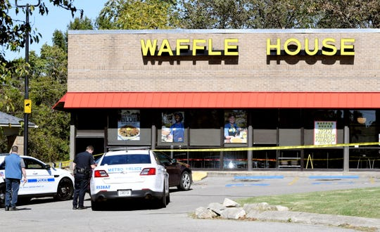 Nashville police work the scene of a shooting at a Waffle House on Wednesday.