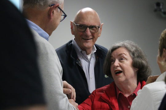 At-large candidate Ann Petersen stands with her husband, Jim. The two were talking to Franklin Mayor Ken Moore at early voting returns on Tuesday.