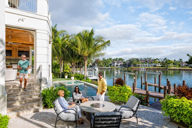 Available for $13,475,000, the 4,395 square foot Gordon Drive estate was designed to maximize views of Keewaydin Island.