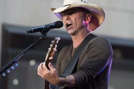 """FILE - In this Tuesday, Sept. 23, 2014, file photo, Kenny Chesney performs on NBC's """"Today"""" show in New York. His new album, """"Some Town Somewhere"""" drops Friday. (Photo by Charles Sykes/Invision/AP, File)  Charles Sykes FILE - In this Tuesday, Sept. 23, 2014, file photo, Kenny Chesney performs on NBC's """"Today"""" show in New York. His new album, """"Some Town Somewhere"""" drops Friday. (Photo by Charles Sykes/Invision/AP, File)"""