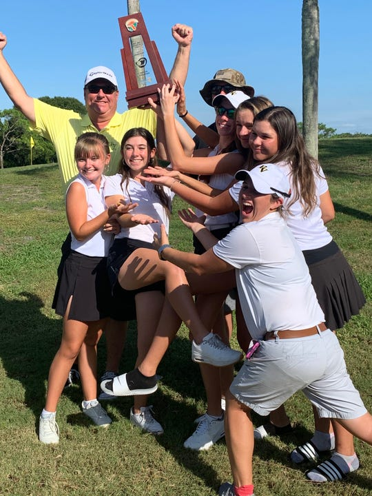 The Bishop Verot Catholic High School girls golf team celebrates winning the Class 1A-Region 3 title on Wednesday, Oct. 23, 2019 at The Meadows Country Club in Sarasota.