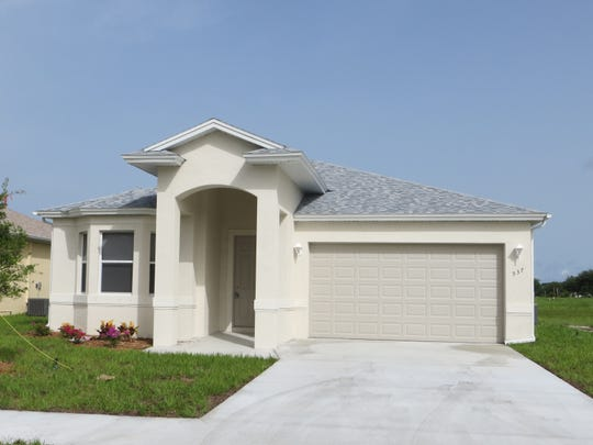A previously completed home using the Casa Feliz design at Arrowhead Reserve, a community of single-family homes off Lake Trafford Road in Immokalee.