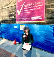Connie Hawk, executive director of the Licking County Foundation, announces plans Wednesday for the famed Louis Sullivan Building behind her.