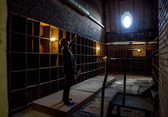 Stan Glasky, a member of Heritage Ohio, explores one of the empty records rooms in the attic  of the Licking County Courthouse during a tour Tuesday afternoon.