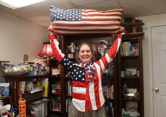 "Robin Hayes is a staunch Republican and Trump supporter now running for the Delaware state legislature. She presently runs a small business as a nutritionist in Dover but when campaigning she is known as the ""Flag Lady"" due to her different types of flag inspired apparel.."