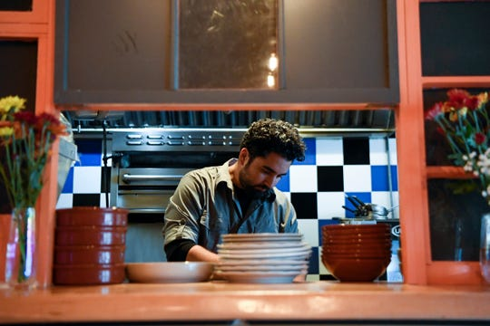 Chef Meny Vaknin cooks in the kitchen of his restaurant, MishMish Cafe, on Wednesday, Oct. 23, 2019, in Montclair.
