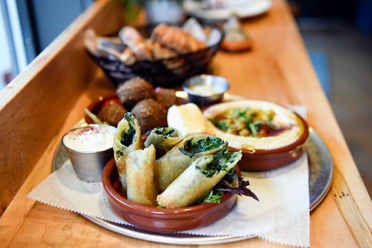 """The Turkish """"cigars"""" with cheese and spinach at MishMish Cafe on Wednesday, Oct. 23, 2019, in Montclair."""