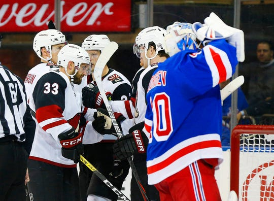 Arizona Coyotes left wing Lawson Crouse (67) is congratulated after scoring a goal as New York Rangers goaltender Alexandar Georgiev (40) looks away during the first period at Madison Square Garden.