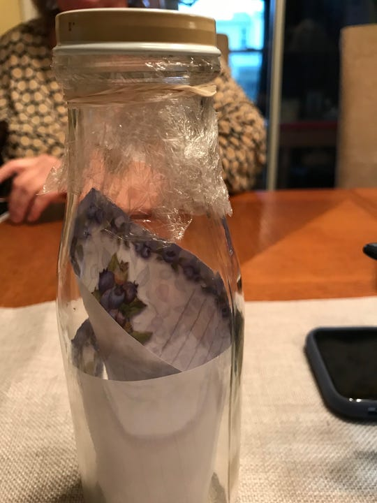 Mock up of the bottle the Romanek family launched in May of shore of Sandy Hook the plastic wrap and rubber band was meant to keep note dry.