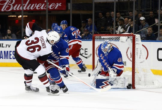 New York Rangers goaltender Alexandar Georgiev (40) makes a save against the Arizona Coyotes during the first period at Madison Square Garden.