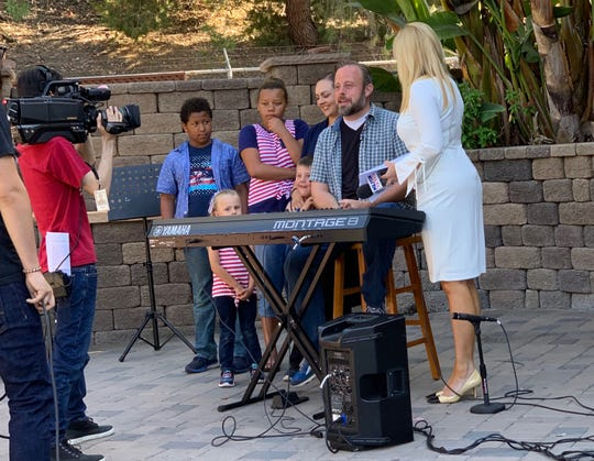 """Sheldon Pickering performs """"America the Beautiful"""" live on television while members of his family watch during a performance in San Diego over the summer."""