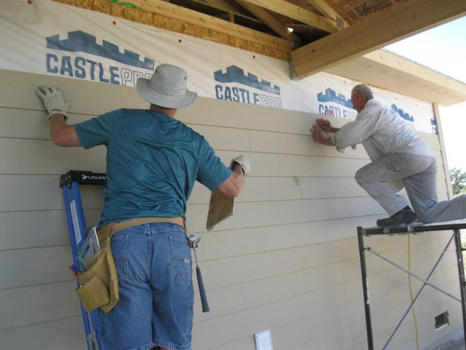 Siding is installed on a Tres Rios Habitat for Humanity home on Crouch Mesa on July 28, 2019, by volunteers from the local carpenters union and the community. The deadline for applying for a new Habitat home is Oct. 2, 2021
