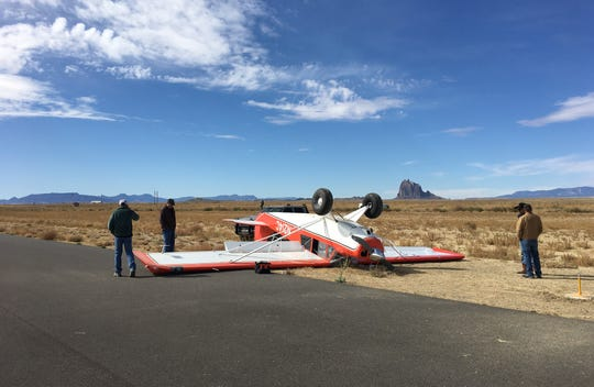 An overturned aircraft rests near the runway at the Shiprock Airstrip on Oct. 23.
