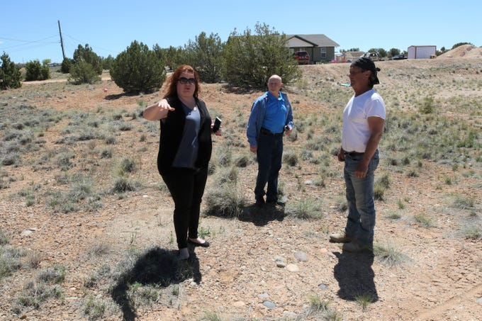 Hope Tyler, left, Frank Hayes and Greg Anderson of Tres Rios Habitat for Humanity survey the site of the new home the organization will construct on Crouch Mesa in late April.