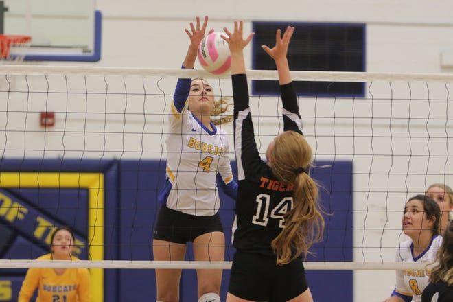 Bloomfield's Katie Waresback hits a free ball over the net on a counterattack against Aztec during Tuesday's District 1-4A volleyball match at Bobcat Gym in Bloomfield.