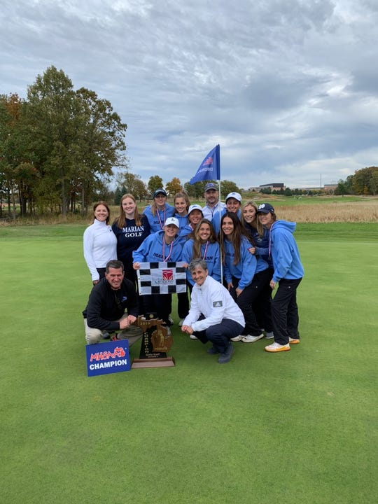 The Marian girls golf team celebrates its Division 3 state title win.