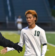 Taiga Shiokawa gets a low-five from a teammate as the final whistle sounds on a 2-0 Novi win.