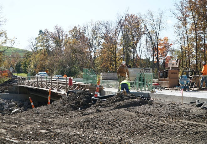 Work continues on Oct. 23, 2019 on the replacement of a bridge on Lilley Road just north of Michigan Ave.