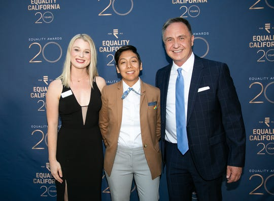 Palm Springs City Councilmember Christy Holstege, Community Leadership Award recipient Alexis Ortega and Equality California Executive Director Rick Zbur arrive at Equality California's 2019 Palm Springs Equality Awards.