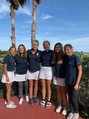 The Gulf Breeze girls golf team, led by head coach Dawn Hundley, celebrate a runner-up finish at the Region 1-2A golf meet at Tiger Point. The Class 2A state tournament will be held Nov. 4-5 at the Mission Inn Resort & Club in Howey-in-the-Hills.