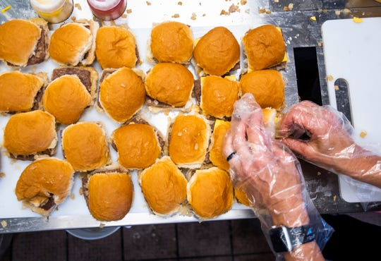 Sliders are made at the opening of the first White Castle in Arizona in the Talking Stick Entertainment District near Scottsdale on Oct. 23, 2019.