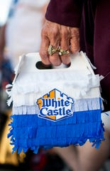 A craver holds a White Castle box at the first White Castle in Arizona in the Talking Stick Entertainment District near Scottsdale on Oct. 23, 2019.