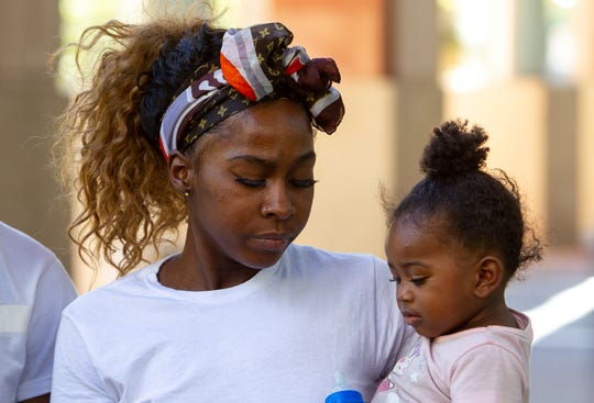 Iesha Harper and her daughter appear at a press conference on Oct. 22, 2019, outside Phoenix City Hall.
