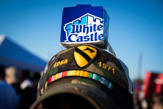 A man dons a makeshift White Castle hat at the opening of the first White Castle in Arizona in the Talking Stick Entertainment District near Scottsdale on Oct. 23, 2019.