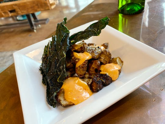 Wood roasted sunchokes with Calabrian chile aioli, kale chips and rosemary at Persepshen in Phoenix.