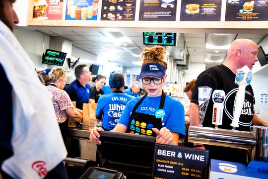 White Castle employee Trinity Berry takes an order at the opening of the first White Castle in Arizona in the Talking Stick Entertainment District near Scottsdale on Oct. 23, 2019.
