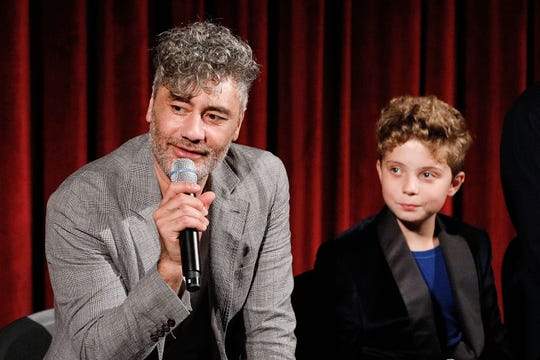 """Taika Waititi and young co-star Roman Griffin Davis attend a screening of """"JoJo Rabbit"""" on Oct. 17, 2019, in New York City."""