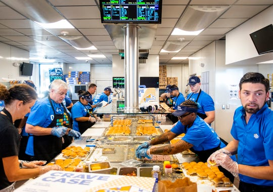 White Castle employees make food at the opening of the first White Castle in Arizona in the Talking Stick Entertainment District near Scottsdale on Oct. 23, 2019.