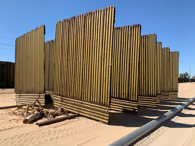 Construction crews set up mobile landing mat fencing to use as they tear down aging fencing in San Luis, Arizona. These panels will be placed at the border temporarily, as workers install permanent, 30-foot bollard fencing.