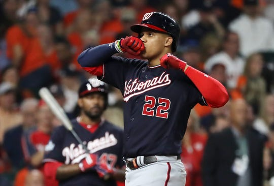HOUSTON, TEXAS - OCTOBER 22:  Juan Soto #22 of the Washington Nationals celebrates his solo home run against the Houston Astros during the fourth inning in Game One of the 2019 World Series at Minute Maid Park on October 22, 2019 in Houston, Texas. (Photo by Elsa/Getty Images)