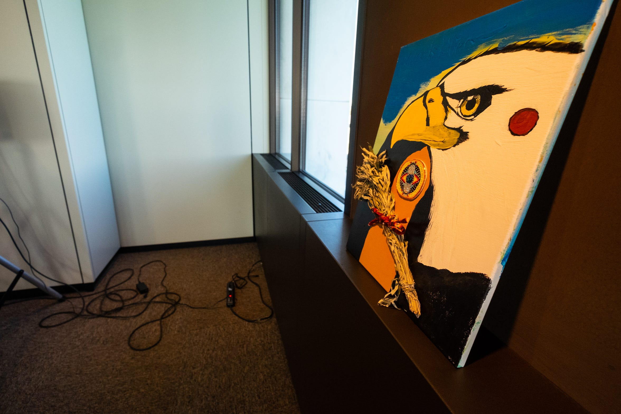 A Native American painting presented to the city sits in the fourth floor conference room in the Municipal Office Center after a press conference to announce the city's office of diversity, equity and inclusion.