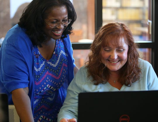 Betty Cooper, one of the Adriance Memorial Library's technology instructors speaks with Denise Austin of Amenia following a computer class in the library's Marcotte computer lab in the City of Poughkeepsie on October 23, 2019.