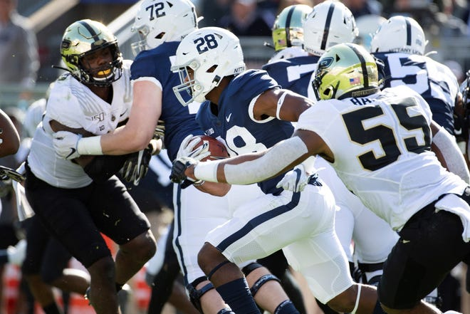 Penn State running back Devyn Ford (28) gains yardage against Purdue during an NCAA college football game in State College, Pa., on Saturday, Oct. 5, 2019. (AP Photo/Barry Reeger)