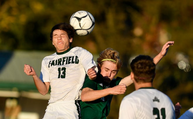 Fairfield's Marcus Pruy,  and Ben Bullen of York Catholic try to get a head on the ball during the District 3 Class 1-A boys' soccer quarterfinal game, Wednesday, October 23, 2019.