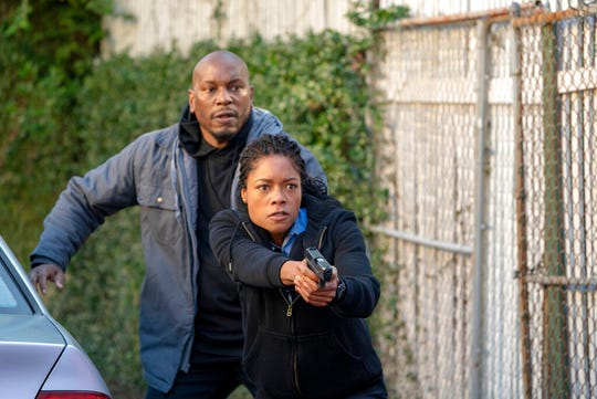 "Naomie Harris, left, and Tyrese Gibson star in ""Black and Blue."" The movie is playing at Regal West Manchester, Frank Theatres Queensgate Stadium 13 and R/C Hanover Movies."
