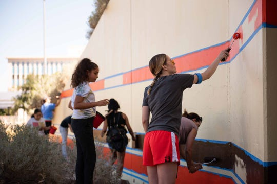 Art Belongs Here grant recipients work on a mural at Keystone Avenue and Foster Drive in October 2019.