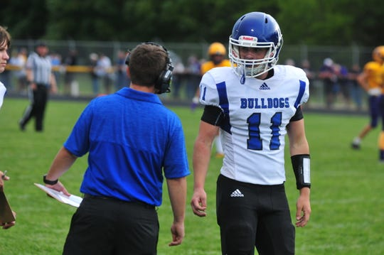 Centerville quarterback Ryan Dickenson (11) has amassed 1,216 total yards and 13 total touchdowns this season.