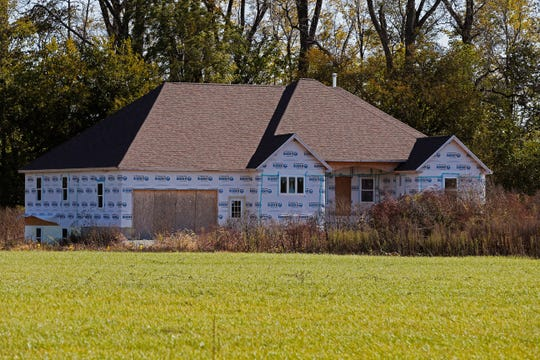 This home at 8875 Boundary Road near Fountain City sits unfinished because the Indiana Department of Natural Resources says the building sits in a flood plain.