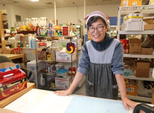 Co-owner Hyosook Lee at the Mini H Mart on North Street.