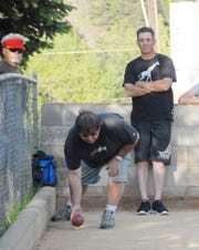 """Paul """"PJ"""" Hall (right) watches a member of the Weed Bocce Club participate in the game in 2011."""