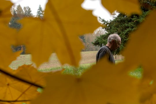 Standing in the backyard of his property, Carey Vanderbeck voices his concern about a nearby county construction project that will affect his property in northeast Salem, on October 23, 2019. Marion County's plan to replace a bridge on Silverton Road will require the removal of nearby trees, and Vanderbeck is upset they won't be replaced after construction.
