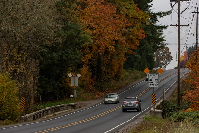Cars drive across a bridge Marion County is planning to replace on Silverton Road in northeast Salem, on October 23, 2019.